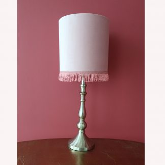 pink table lamp with fringes and metal base